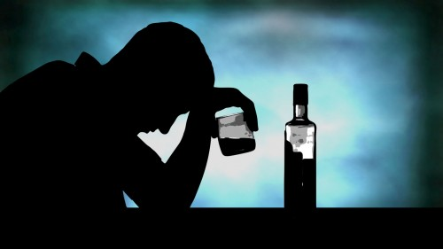 Man Depressed with Bottle