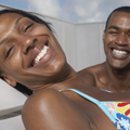 African American couple sunbathing