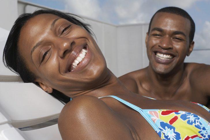 African American couple sunbathing