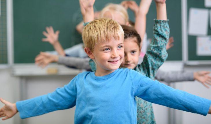 boy-exercising-in-classroom