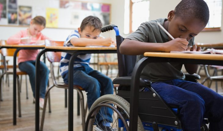 child in wheelchair at school