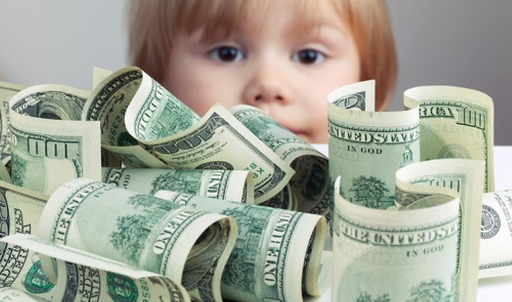 child-looking-at-money