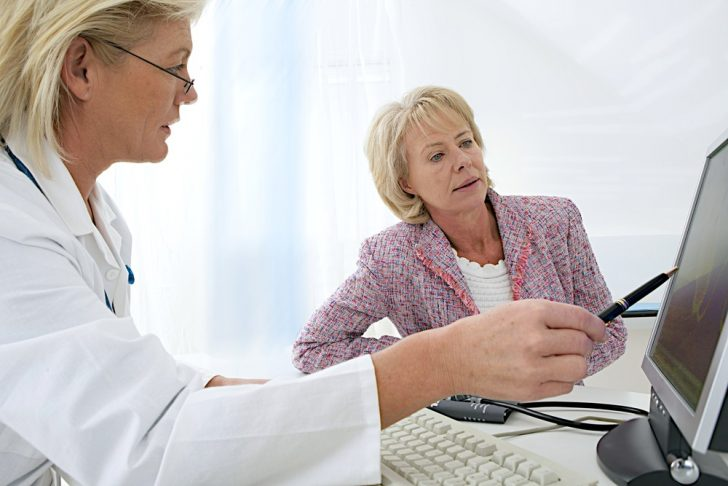 concerned-woman-talking-to-doctor