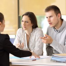 couple-arguing-with-insurance-company-agent