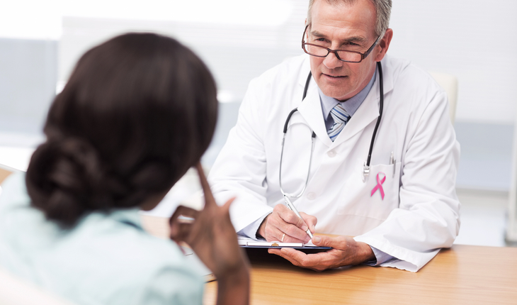 Doctor and patient, breast cancer ribbon