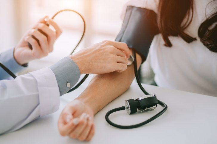 doctor checkinig blood pressure on patient