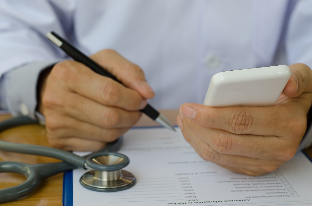 doctor-looking-at-smartphone