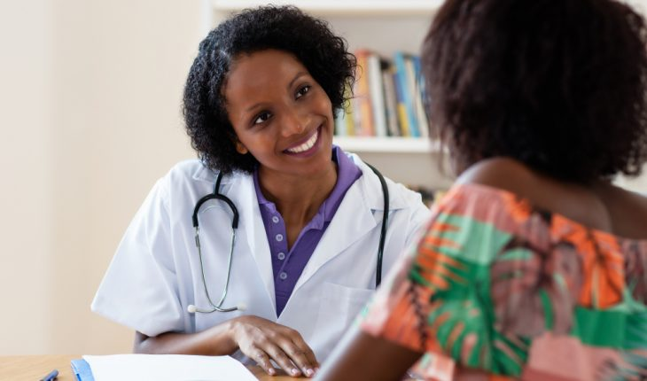 doctor-talking-with-middle-aged-female-patient