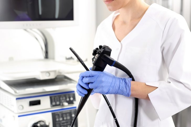 doctor with colonoscopy tools