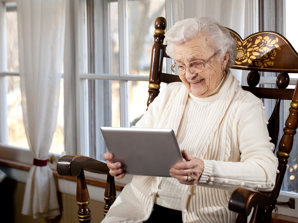 Elderly woman using  tablet.jpg