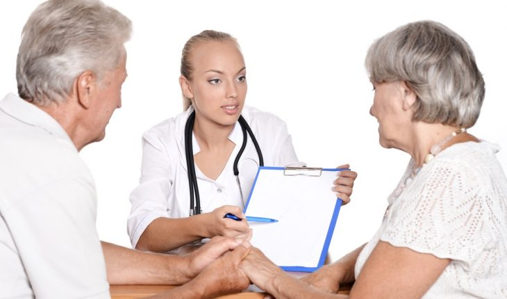 elderly-couple-talking-with-doctor