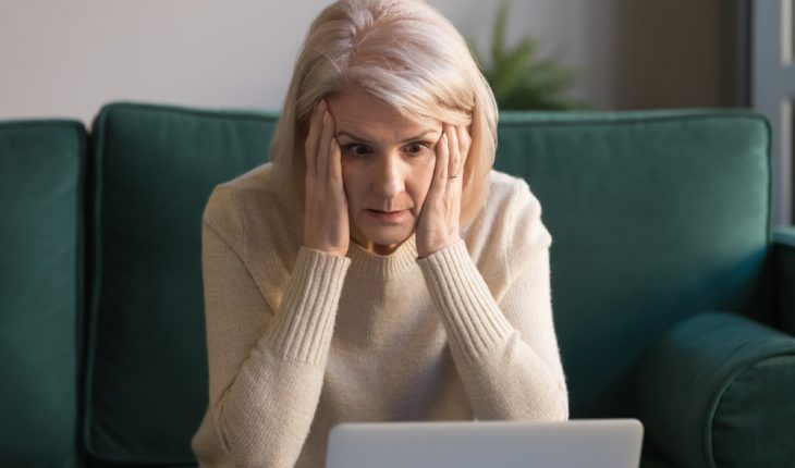 Shocked,Middle,Aged,Mature,Woman,Feeling,Stressed,Reading,Unbelievable,Online