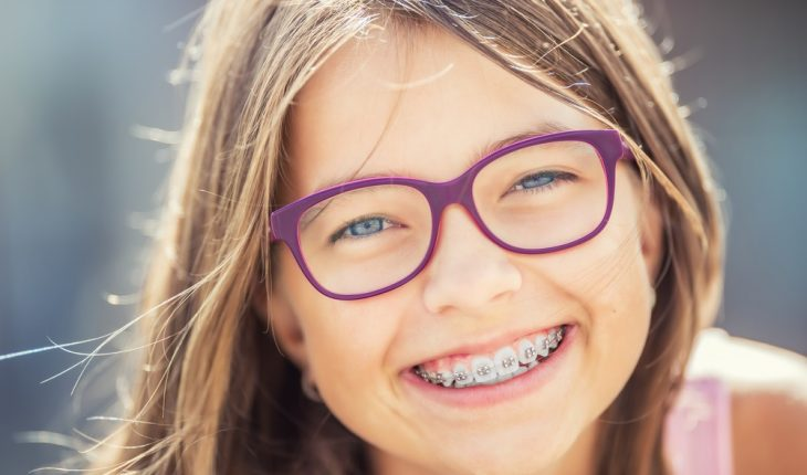 Girl with braces and glasses