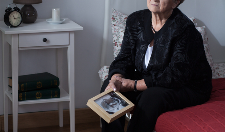 Grieving woman with memento