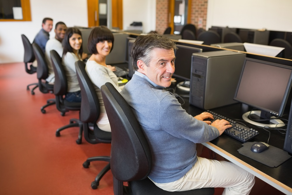 Group of people on computers