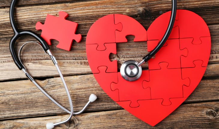 Red,Puzzle,Heart,With,Stethoscope,On,Brown,Wooden,Background