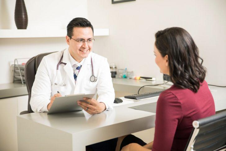 hispanic-woman-talking-to-doctor
