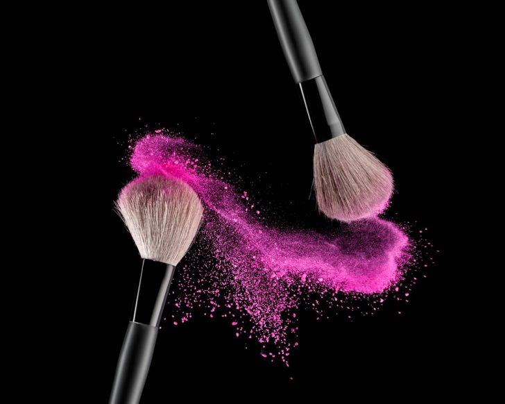 clean makeup brushes with pink powder