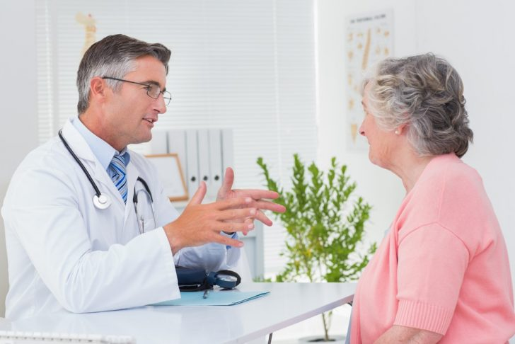Male doctor and female patient