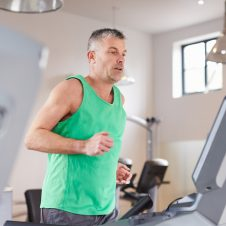 Mature,Man,Running,On,Treadmill,In,Gym