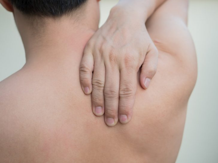 man-rubbing-shoulders