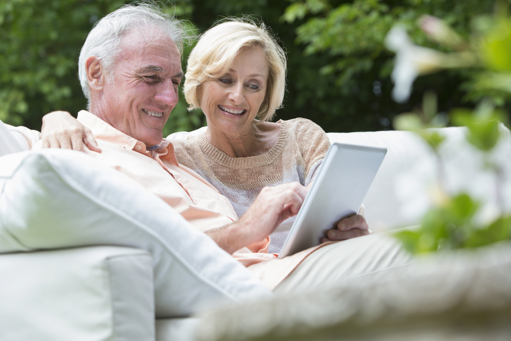 Mature couple with tablet.jpg