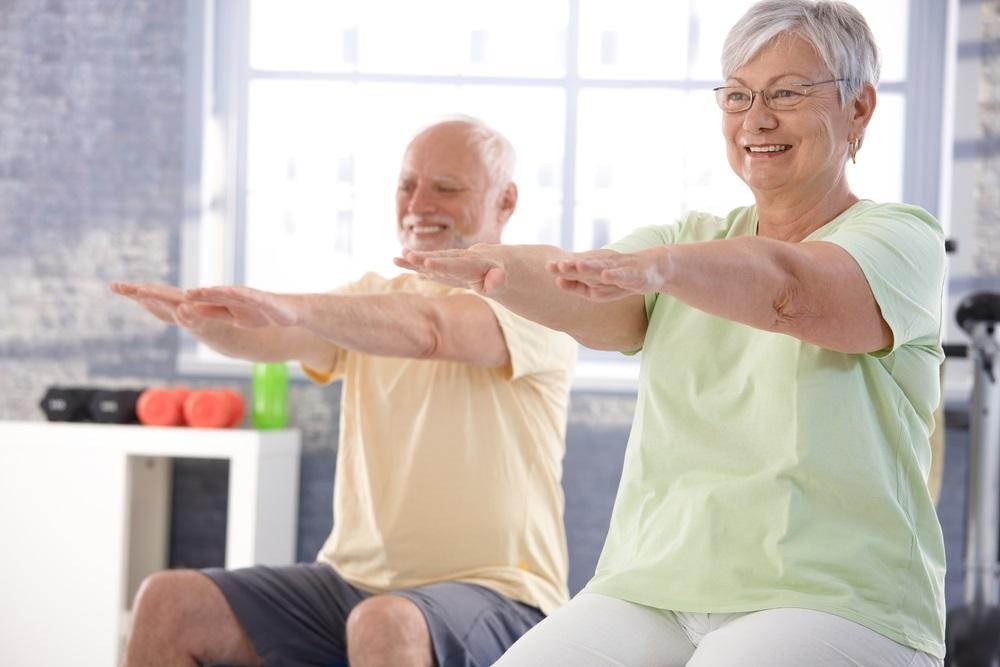mature-couple-enjoying-exercising