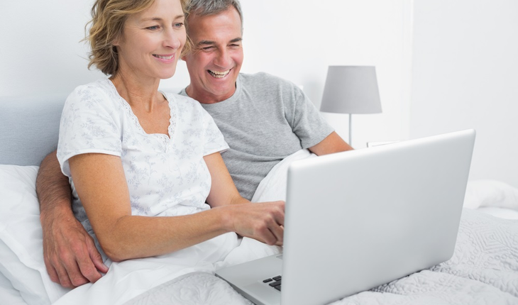 mature-couple-in-bed-with-laptop