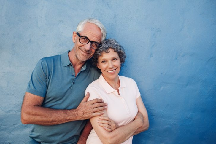 mature-couple-in-front-of-bluel-wall