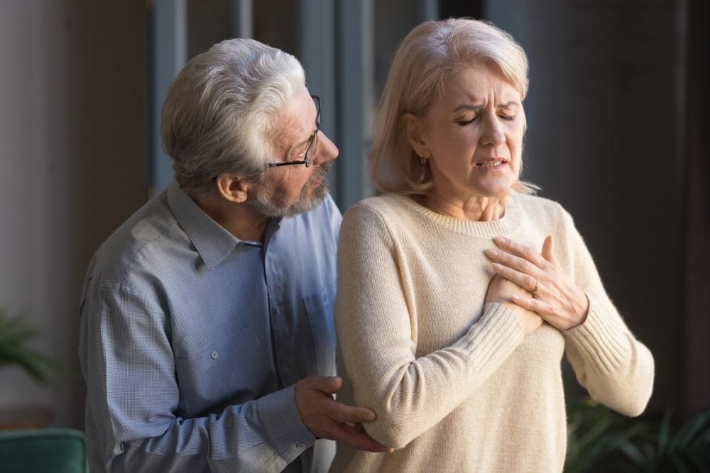 mature-man-comforting-woman-with-heartburn