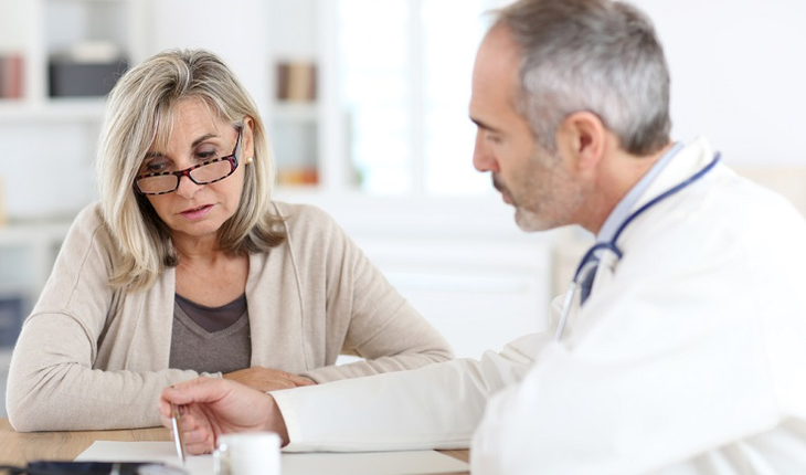 Mature woman consulting with doctor