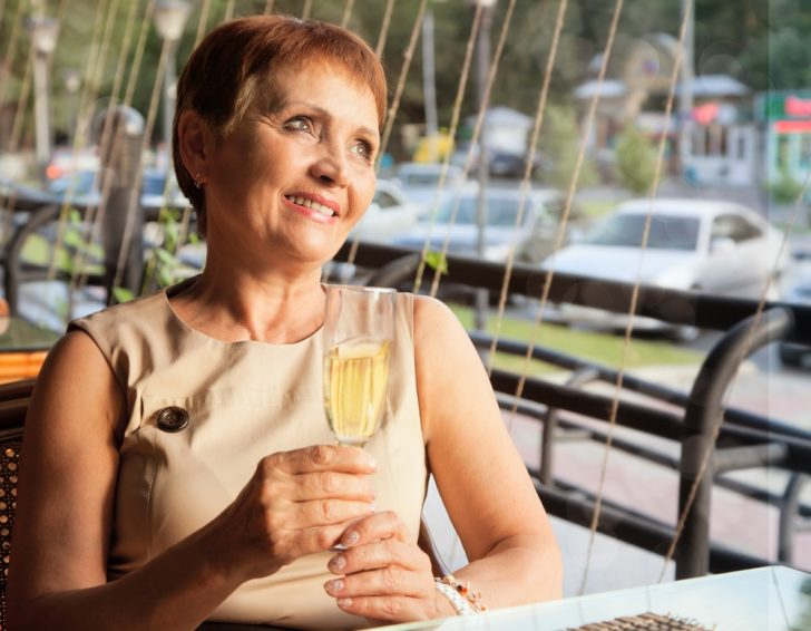 mature-woman-drinking-wine
