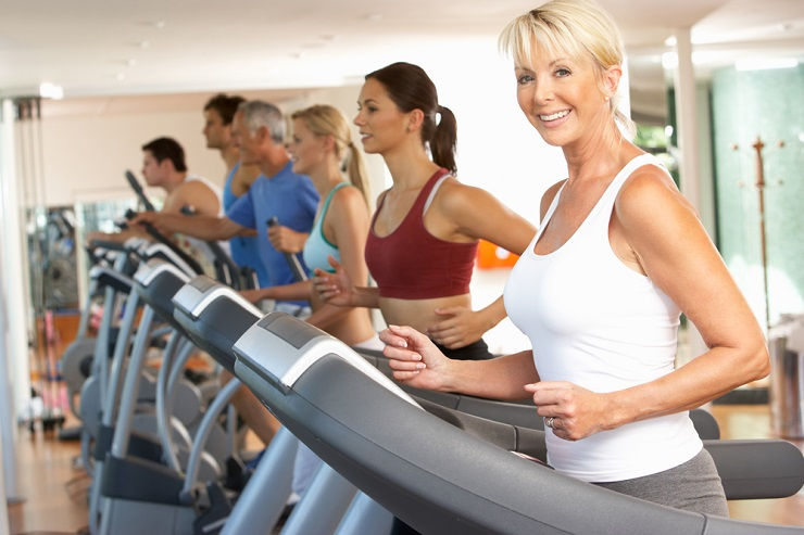 Mature woman in gym class