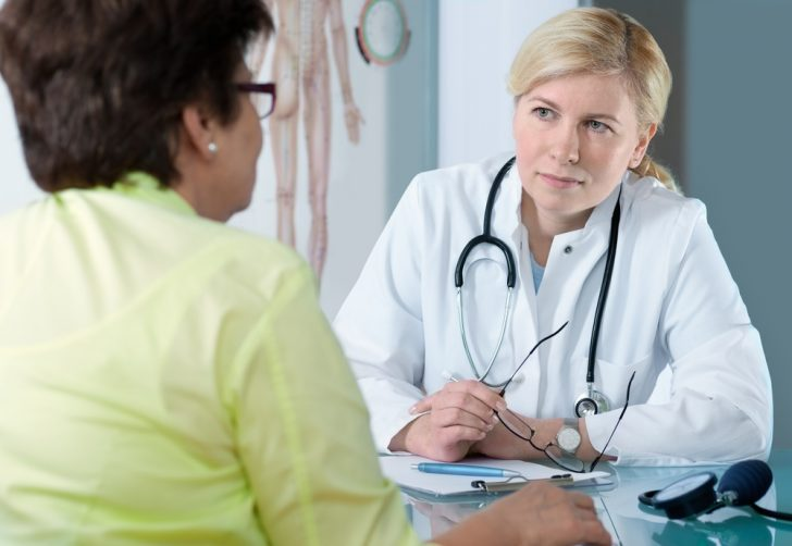 Mature woman patient in doctor's office