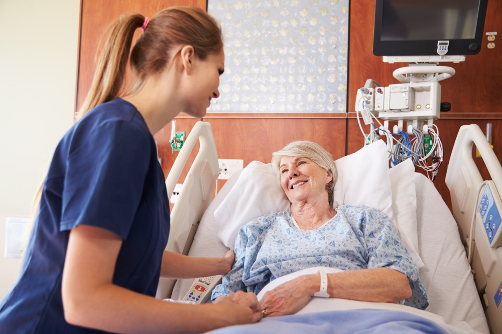 mature-woman-patient-in-hospital-bed