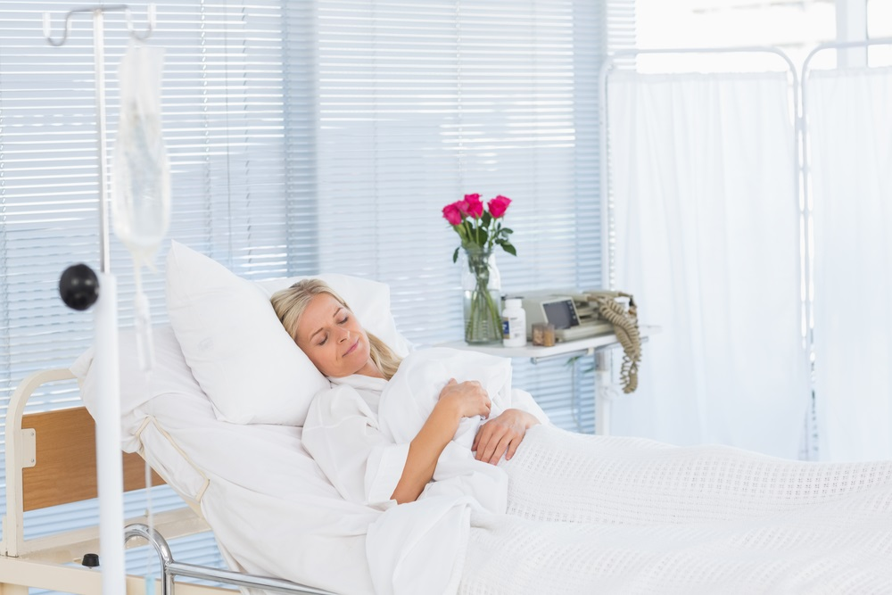 Mature woman patient lying in hospital bed