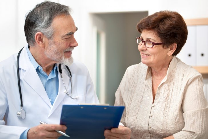 Mature woman patient with doctor