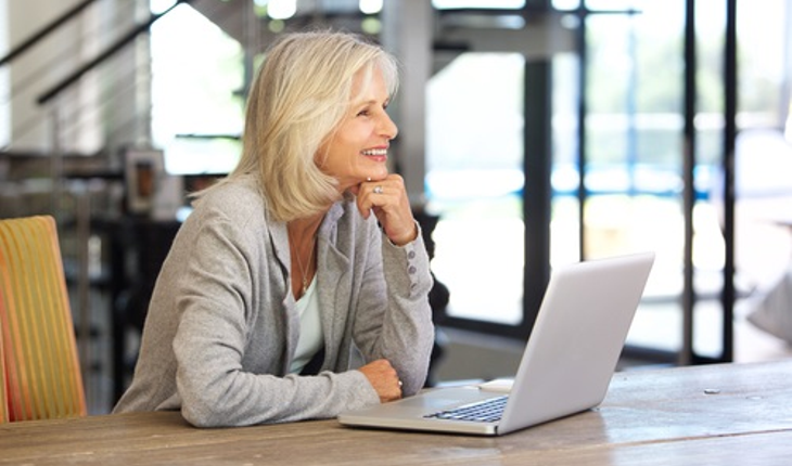Mature woman with computer