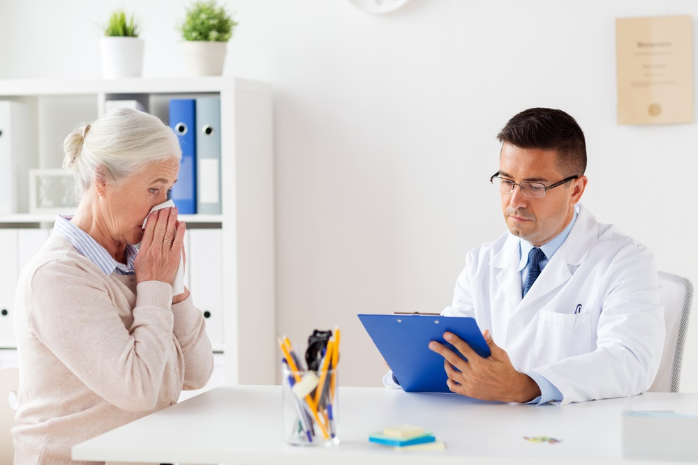 mature-woman-with-doctor-with-clipboard