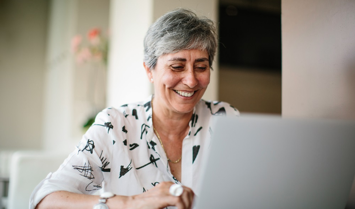 Mature woman with laptop computer