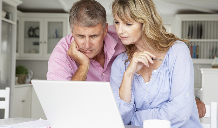 middle-aged-couple-with-laptop
