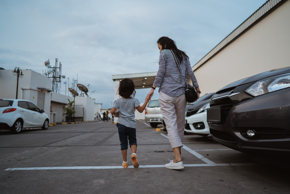 mother-and-daughter-in-parking-lot