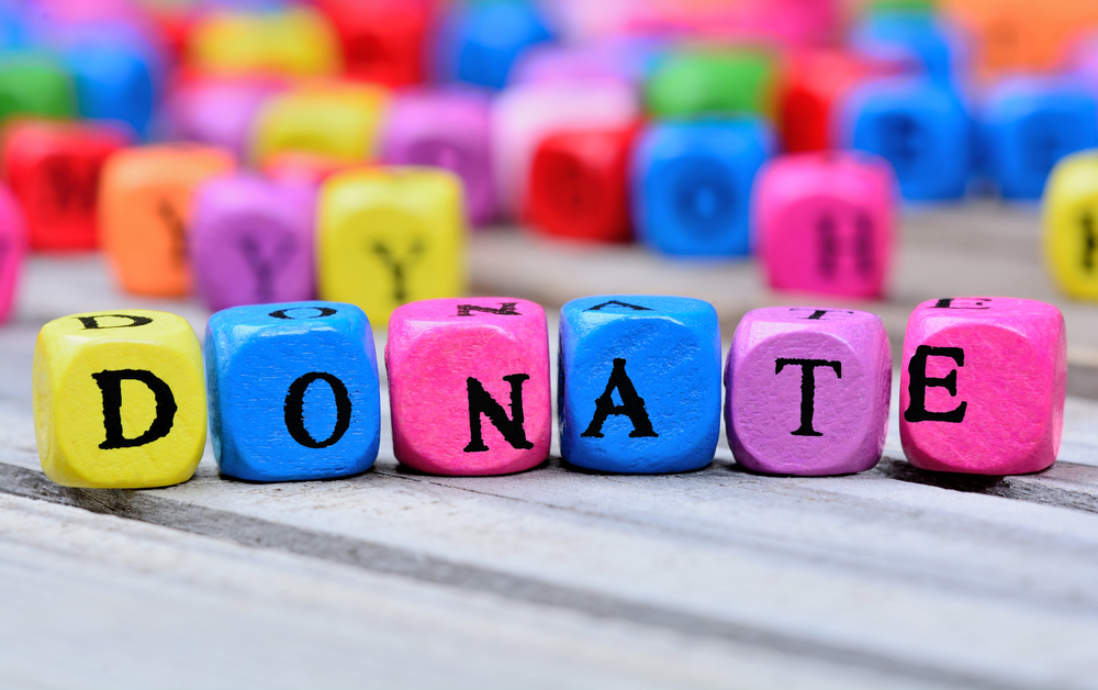 blocks spelling out donate - charitable giving