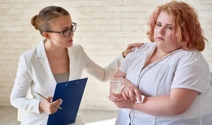 Obese woman with doctor