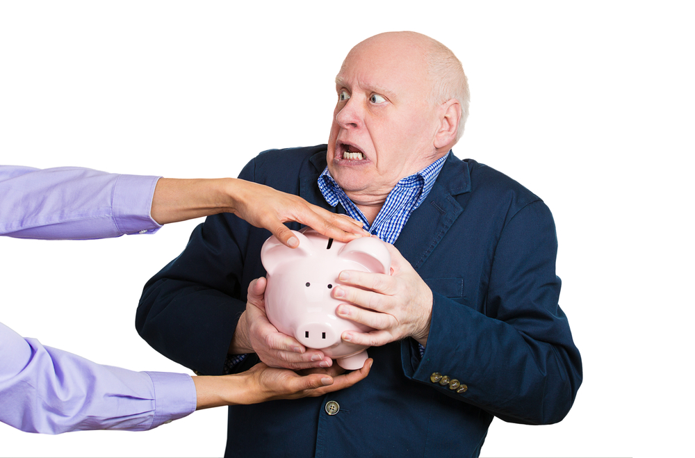 Older man, someone taking piggy bank.jpg