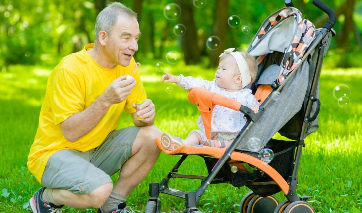 older father and baby in park