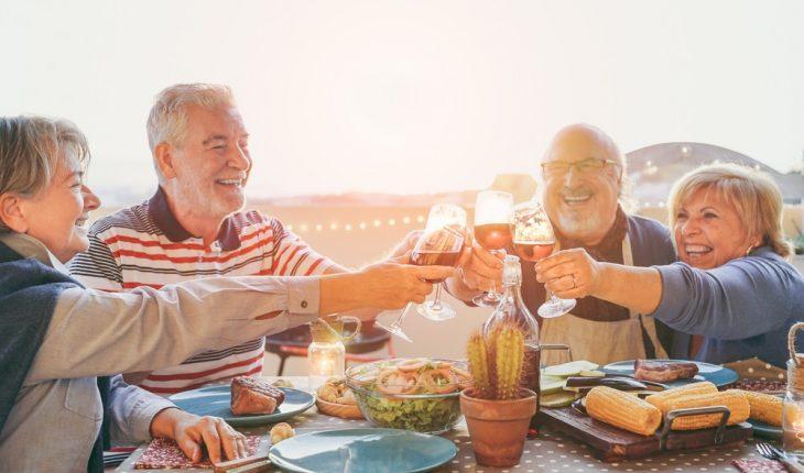 older-people-having-meal-outside