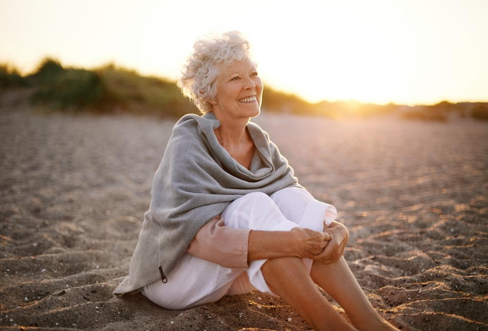 older-woman-alone-on-beach