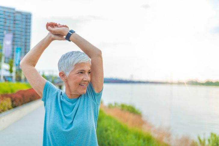 older-woman-doing-arm-stretch