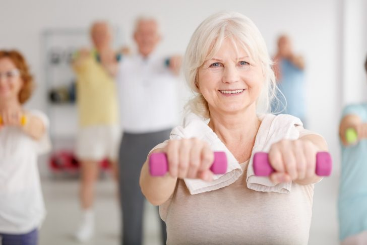 older-woman-exercising-in-class